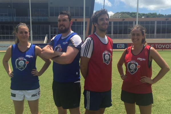 AFL9s players pose