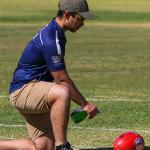 Match Manager cleans the footy in the CAFL