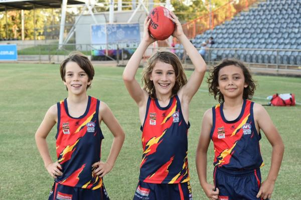 Thunder Juniors girls pose in their new Crows uniform