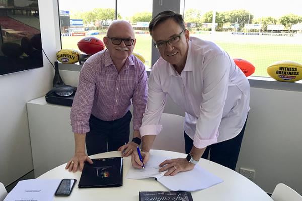 AFLNT CEO Michael Solomon signing with Kym Menzies
