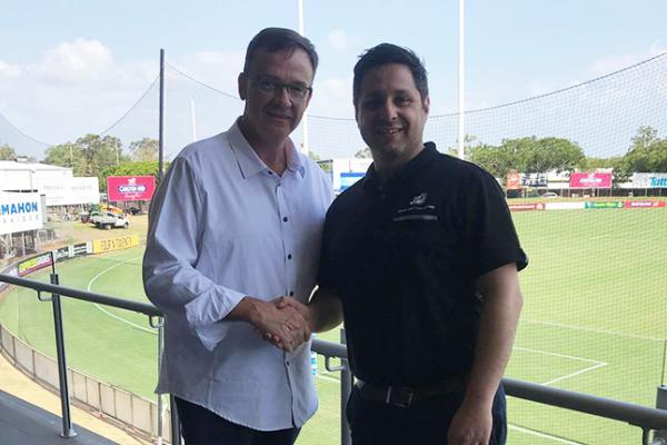 AFLNT CEO Michael Solomon and JS Sports Operations Manager shaking hands
