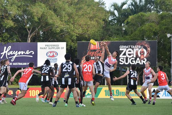 Tah and Magpies ruck man at the ball after a boundary throw in