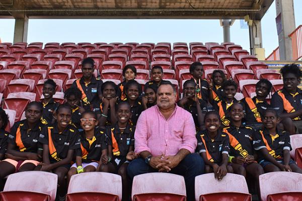 Michael Long with Elcho Eylandt and Ramingining students the day after being awarded NT Australian of the Year