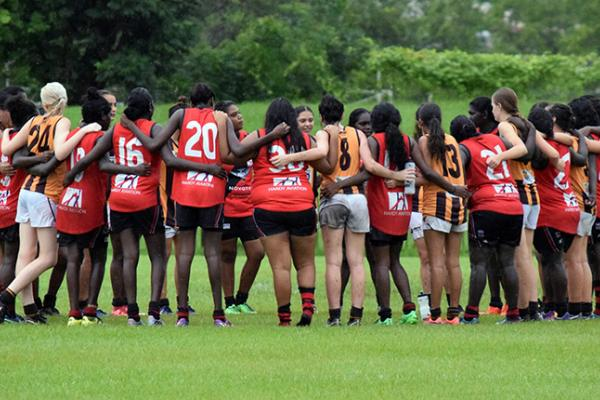 Big River Hawks and Tiwi Bombers players come together