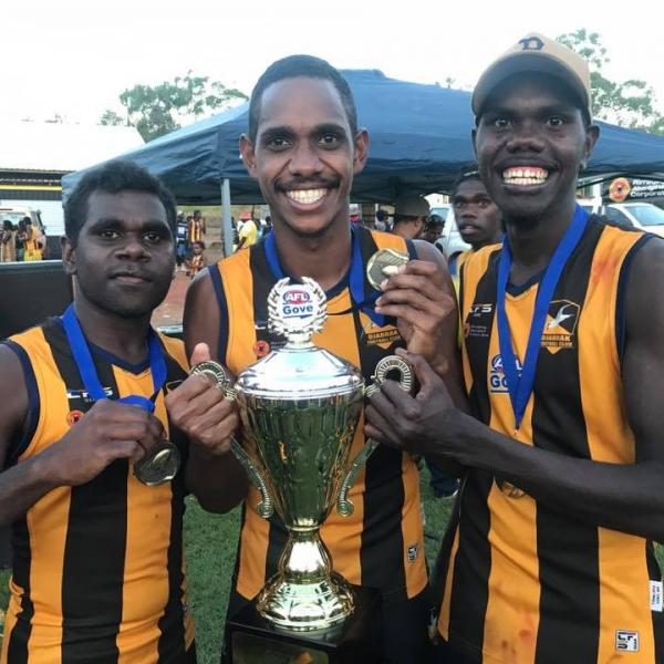 Djarrak players holding the 2017 GAFL Premiership Cup
