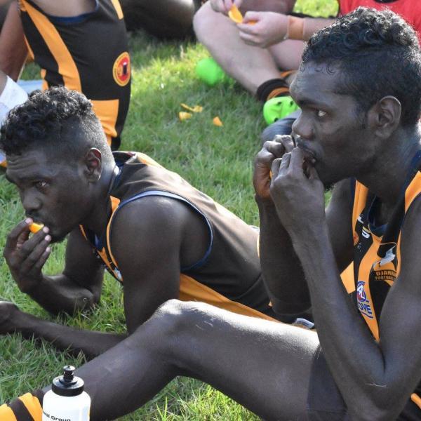 Djarrak players having a quick bite to eat at half time of the GAFL Grand Final