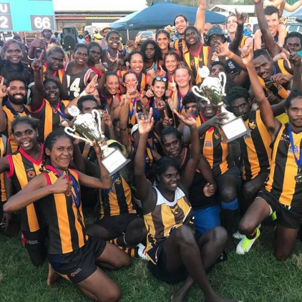 Both the men's and women's Djarrak players celebrating their GAFL grand final wins