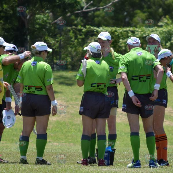 Division 1 umpires at the quarter time break