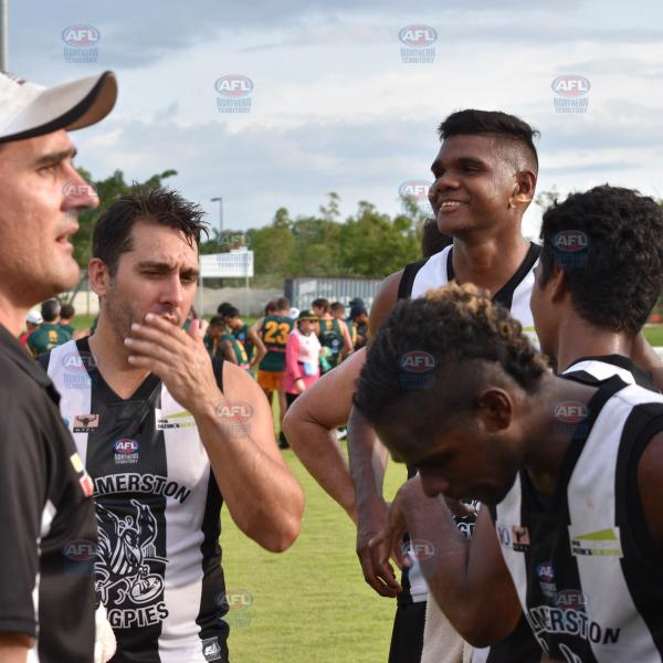 Palmerston coach Tavis Perry speaking with his players at quarter time