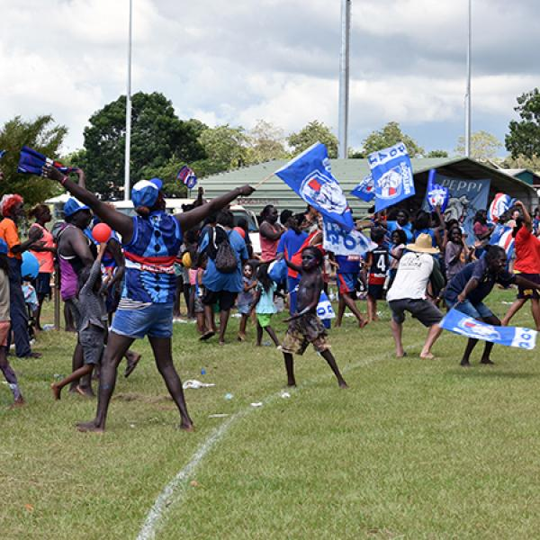 Peppi Bulldogs fans celebrate a goal in Wadeye