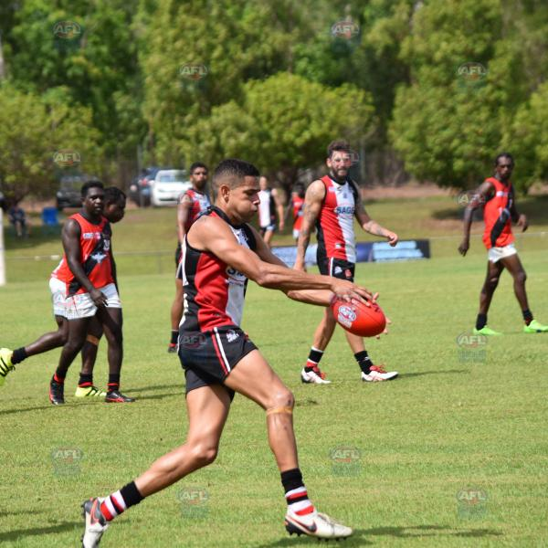 Will Farrer kicking his eighth goal in the Crocs vs Tiwi game
