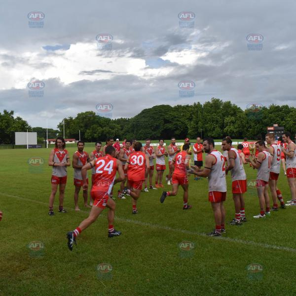 Tahs Div 1 players line up as their Premier League players run onto the field for warm up