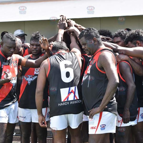 Tiwi Bombers in their team huddle