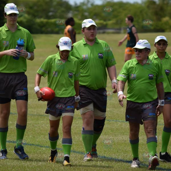 Umpires walking off after a tough game of footy