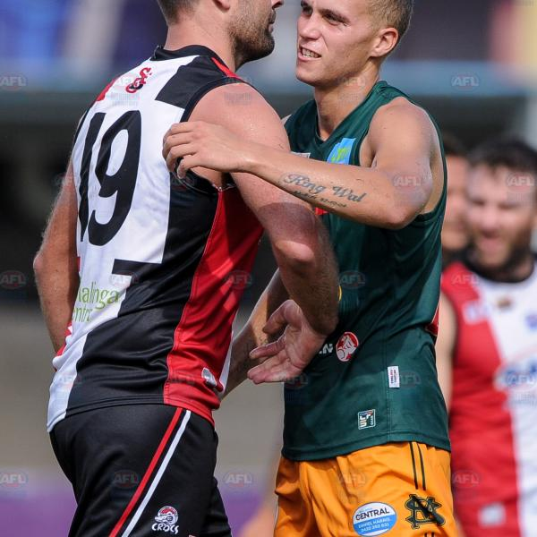 Ex-Essendon team mates Mark Jamar and Shaun Edwards shake hands after the match
