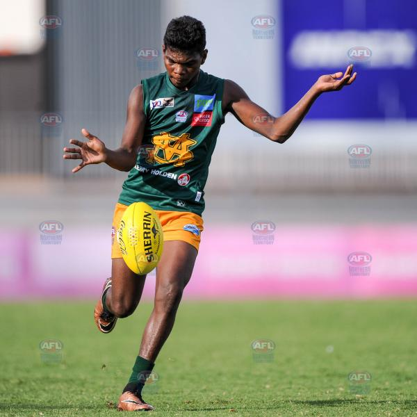 Maurice Rioli launching a kick