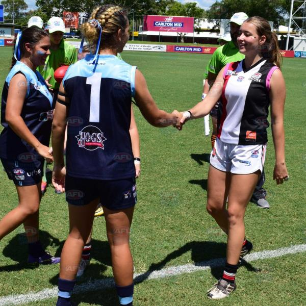 Darwin Buffettes and Southern Districts Captains shaking hands before the Under 18 Girls Grand Final