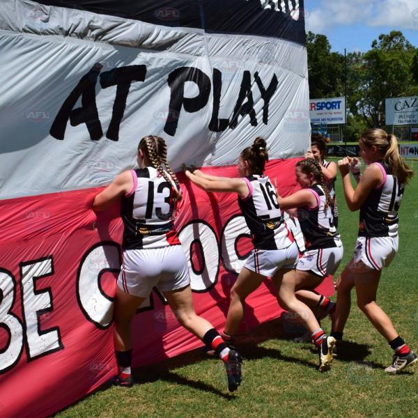Southern Districts girls running through the banner - Under 18 Girls Grand Final