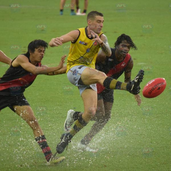 Kicking the heavy and wet ball in the Men's Division 2 Grand Final