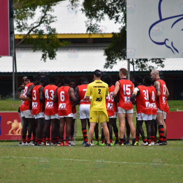Tiwi Bombers in the huddle before the first bounce