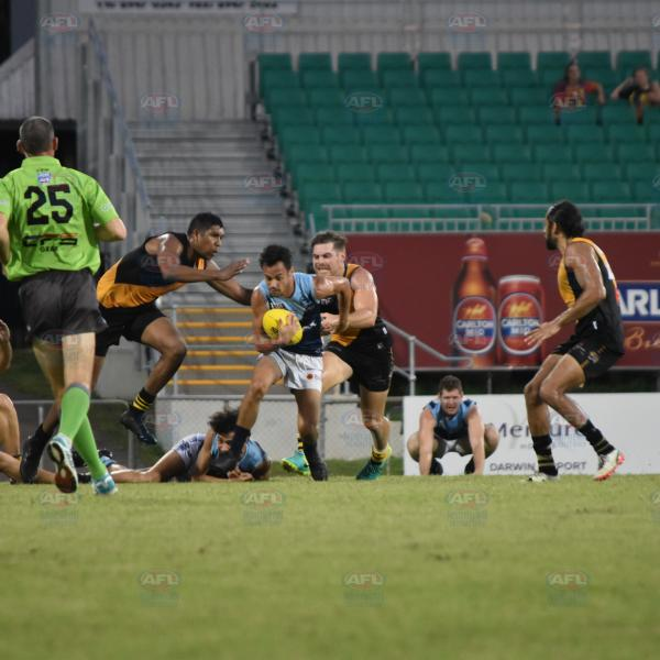 Tim Eldridge doing his best to get the ball out of danger for the Darwin Buffaloes