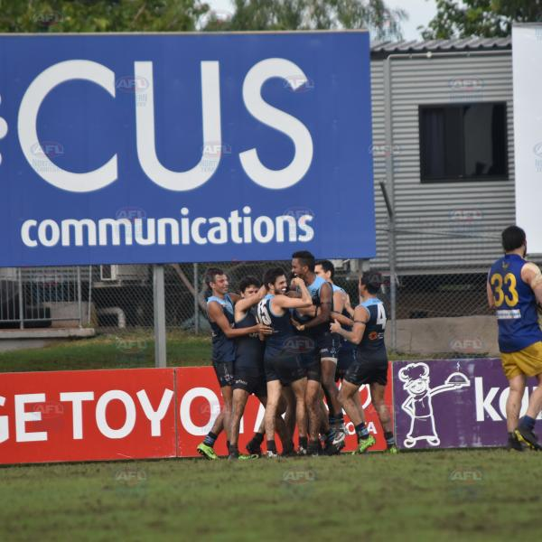 Darwin Buffaloes players celebrating Joel Palmer, Tai Martin-Page's SA, friend who Tai asked