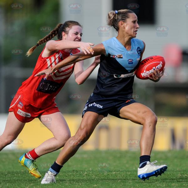 Fending off Tahs players -  Women's Premier League Grand Final