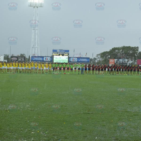 Nightcliff Spartans and Jabiru Bombers players observing the National Anthem before the Men's Division 2 Grand Final