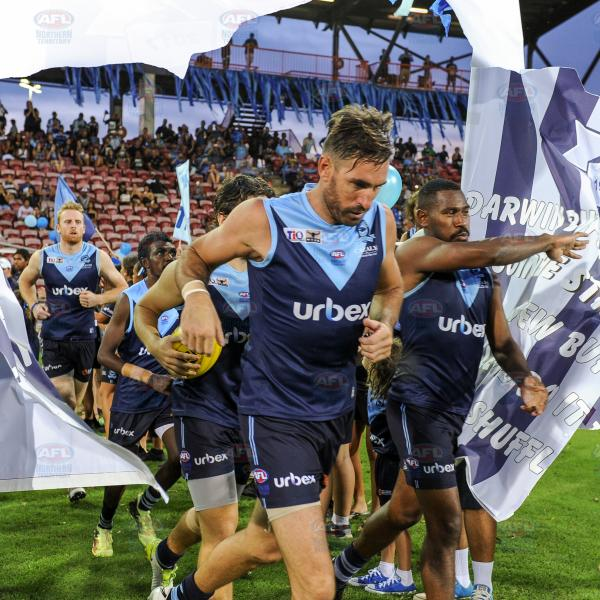 Darwin Buffaloes players running through their banner - Men's Premier League Grand Final