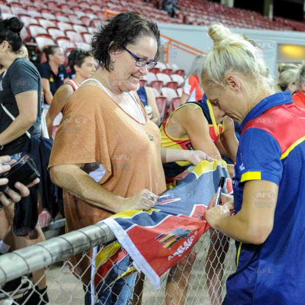 Erin Phillips signing the merch
