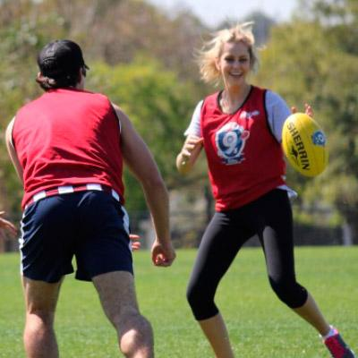 Man and woman playing AFL 9s